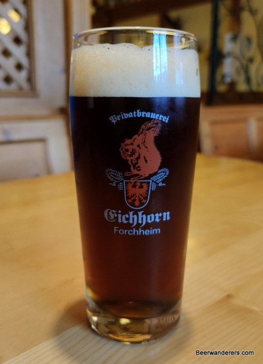 dark beer in logo glass