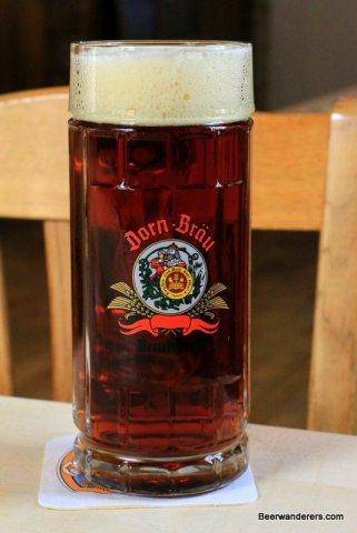 dark beer in mug with logo