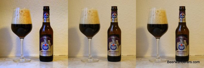 dark beer in wineglass with bottle x three