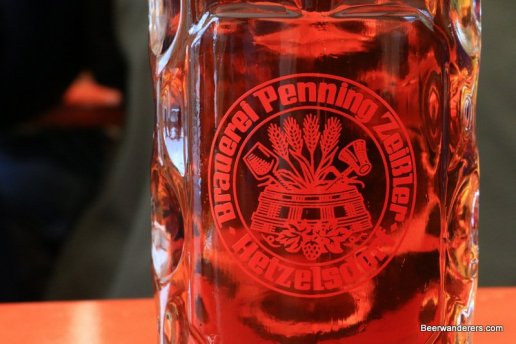 close up of amber beer in logo mug