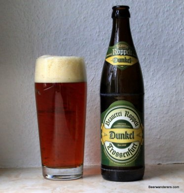 amber beer in glass with glass