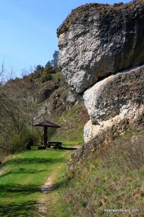 rocking outcropping on trail with picnic bench
