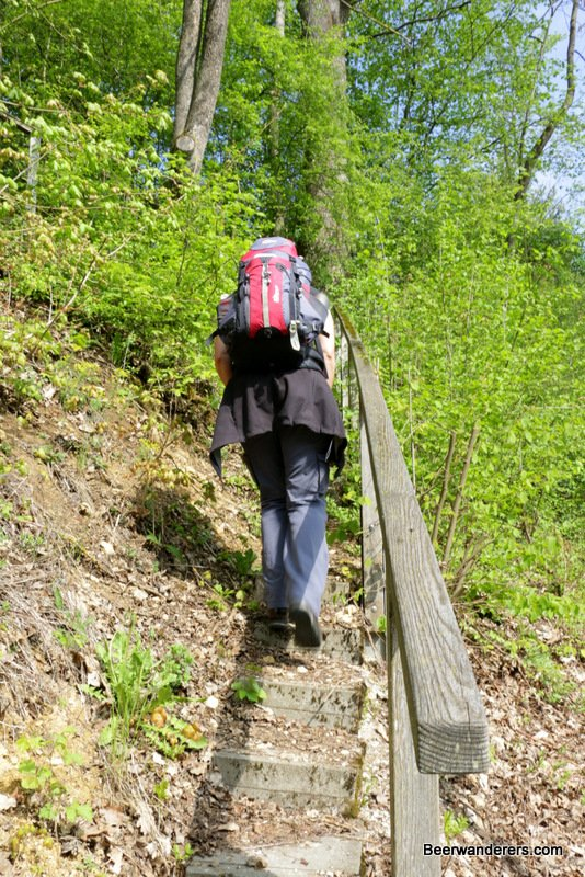 woman hiking up steps