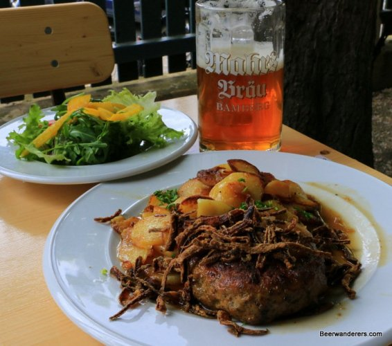 meat and potatoes with salad and beer