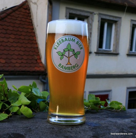 unfiltered golde beer in logo glass