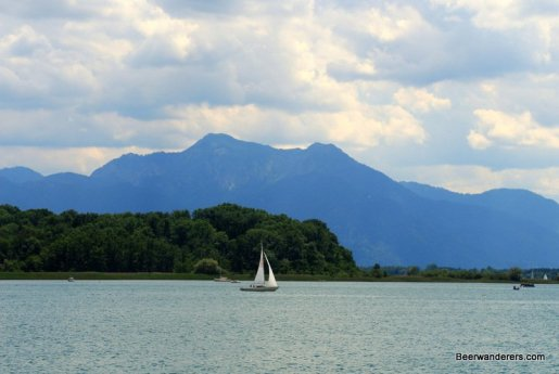 lake with sailboat and mountain in the backgroun