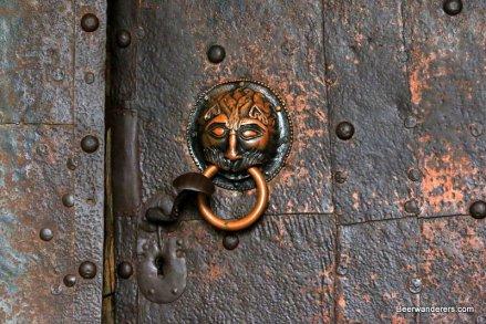 metal door with ornate knob