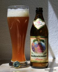weissbier in glass with bottle