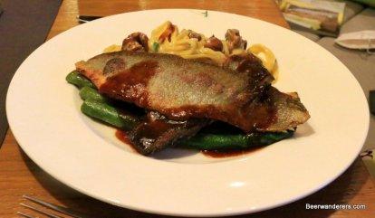 baked fish on asparagus