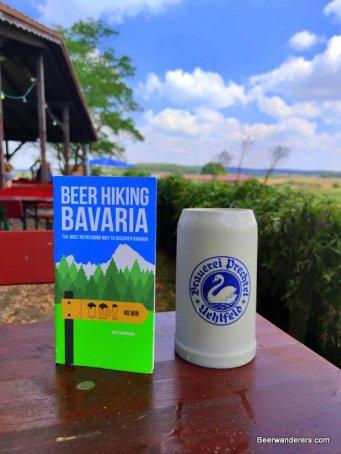 beer book with beer in ceramic mug at bierkeller