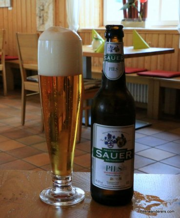 beer in pils glass with bottle