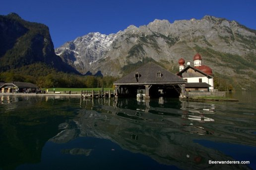 boat house with church on mountain lake