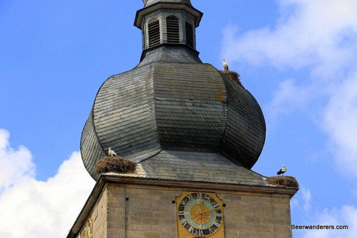 storks nesting on church tower
