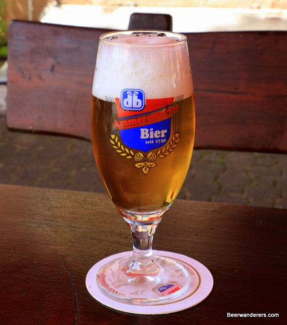 yellow beer in pils glass with logo