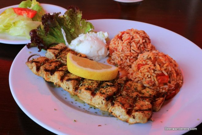 grilled meat on palte with lemon and rice