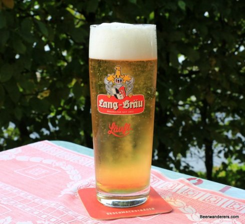 yellow beer in logo glass