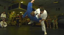 1 US Marine Judoka practicing the Judo throw Harai Goshi (Sweeping Hip), 1 US Marine Judoka practicing Ukemi (Breakfalls)