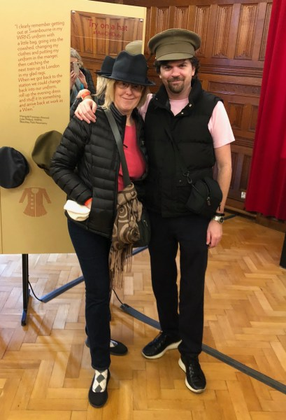 Deirdré and Brendan trying on WWII-era hats at Bletchley Park.
