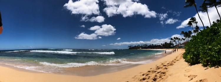 panoramic view of Poipu Beach, Kaua'i.