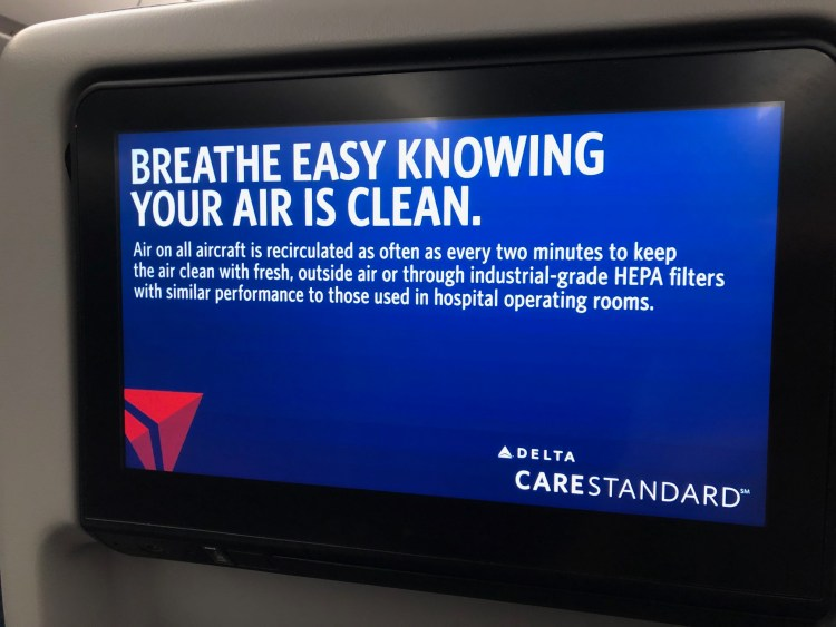 """sign on Delta's in-flight entertainment system saying """"Breathe easy knowing your air is clean"""""""