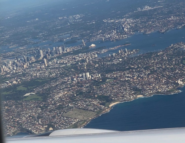 view of Sydney from the air, with the CBD (downtown) and Sydney Opera House