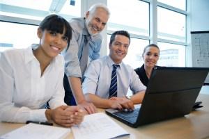 bigstock-Smiling-business-people-sittin-12587240