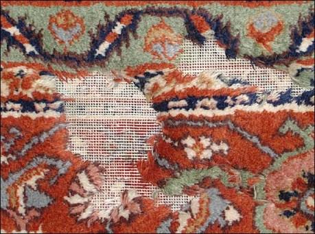 A rug damaged by moths