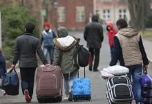 صورة واشنطن تعلّق برنامج قبول اللاجئين العراقيين.