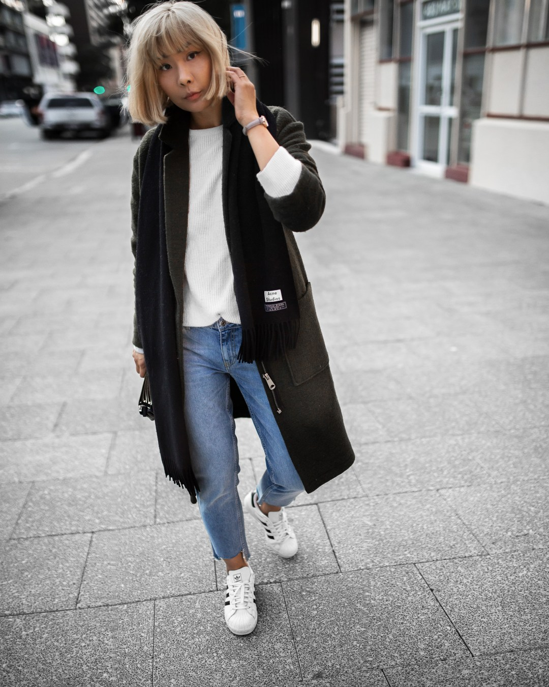 acne-scarf-khaki-coat-stepped-hem-jeans-outfit-inspiration-1-2-copy