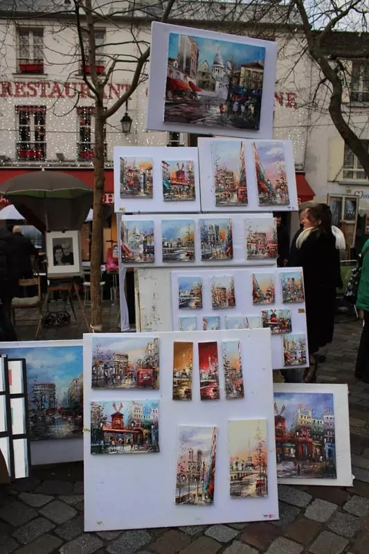 Place du Tertre painting artist, paris arrondissements map, best places to visit in paris, paris arrondissements map, best places to visit in paris