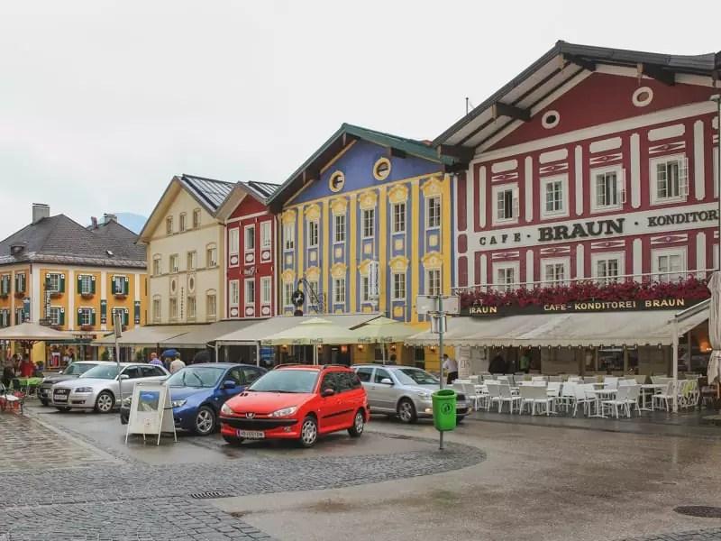salzburg austria sound of music tour city streetscape red car painted houses colors