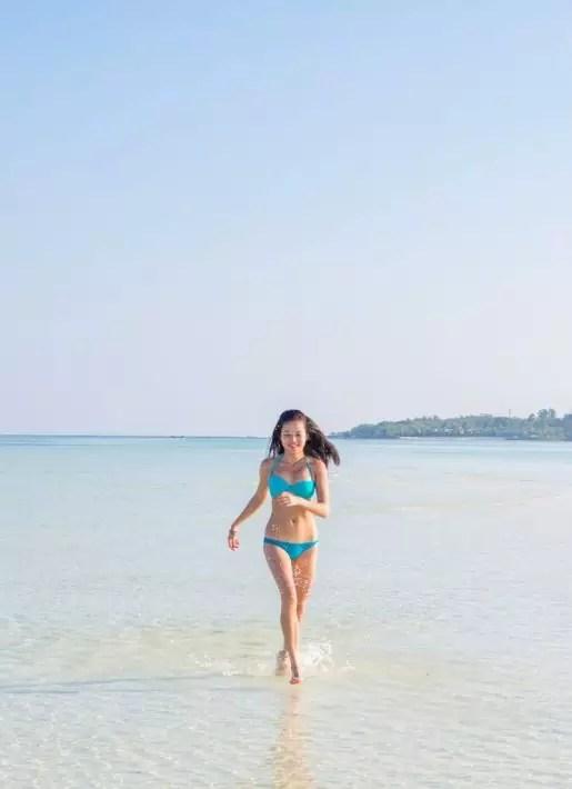 Maldives budget COMO Hotel Cocoa Island run girl beach bikini