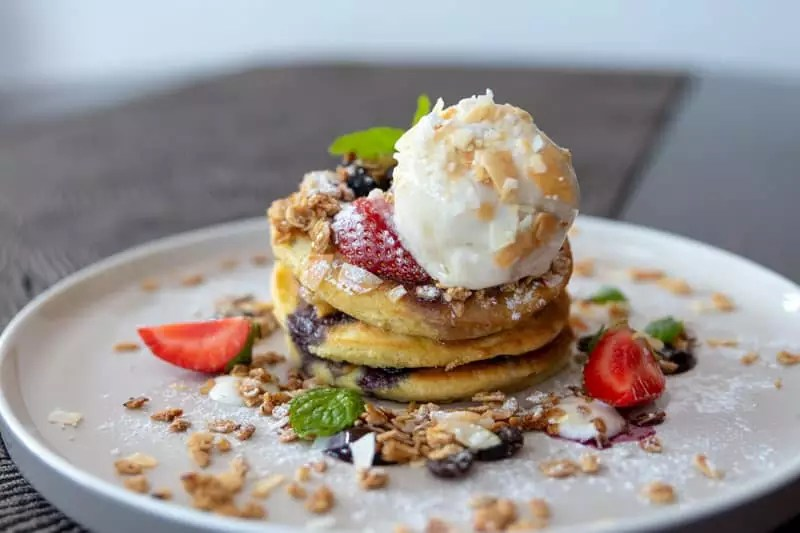The Junction House Cafe Bali Seminyak Kuta Where to Eat in Bali Best Cafes Western Asian Vanilla Pancake Stack Strawberries Dessert