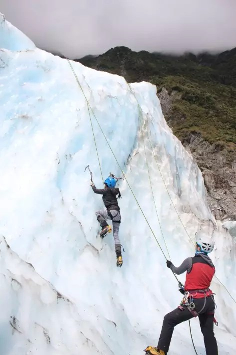 ice climbing girl, fox glacier, new zealand