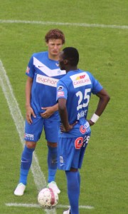 Genk's Jelle Vossen (with Benteke) will miss a few games.