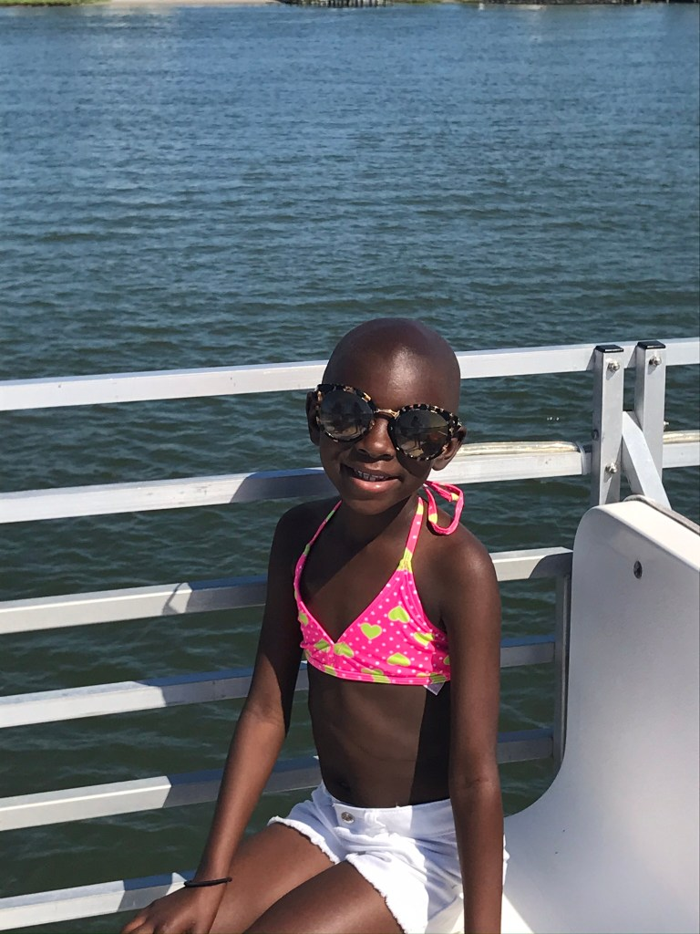 Young girl smiling while enjoying a Believe In Tomorrow respite trip