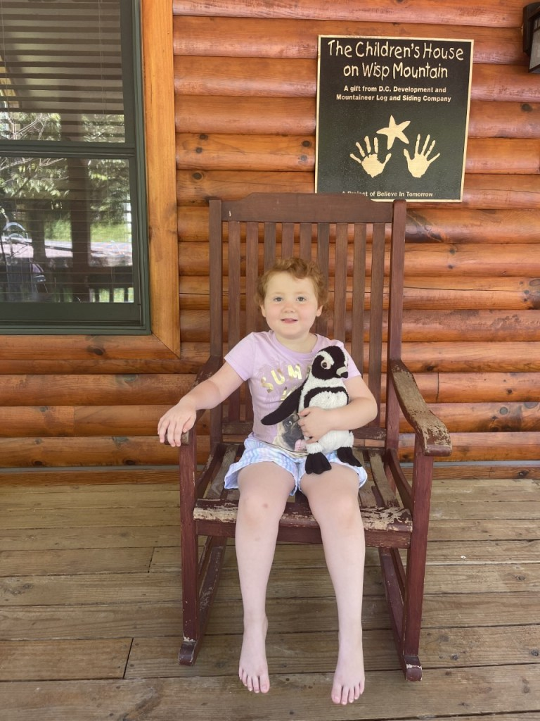Zoey sitting in a rocking chair featured in our stories