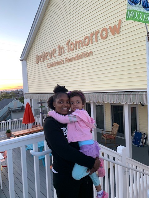 A Believe In Tomorrow Family on the deck of the house by the sea