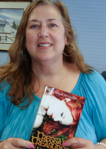 Author with paperback