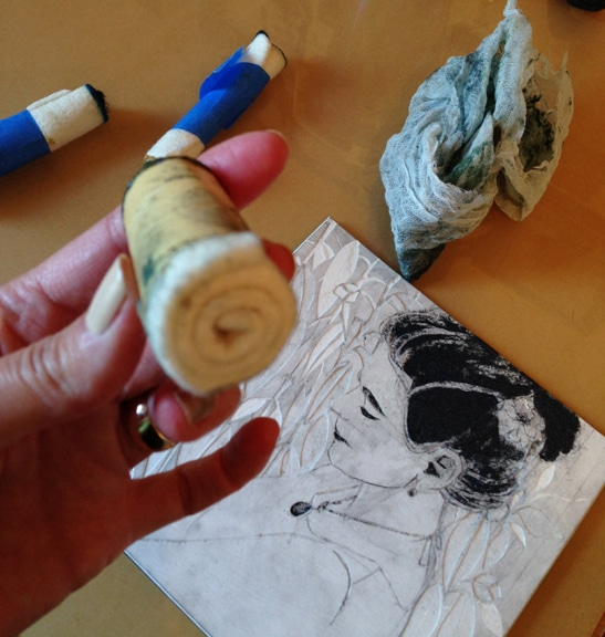 A rolled up piece of felt, hold in a short stump with masking tape, used for inking plates in printmaking
