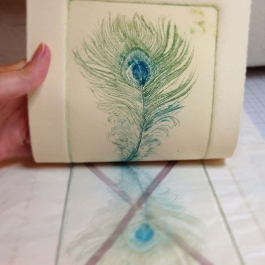 pulling a drypoint etching from a clear plexiglass plate