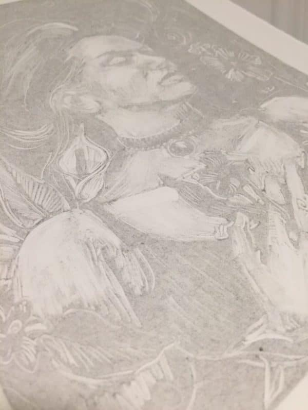 close up of the marks on the figure, and faint, scraped ink printed on the paper