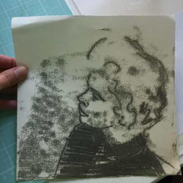 a sketchy black ink trace monotype profile of a woman with cropped hair