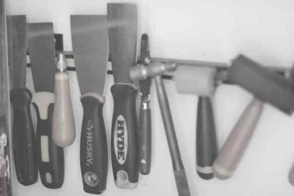 putty knives, carving tools, brayers and palette knives in the studio