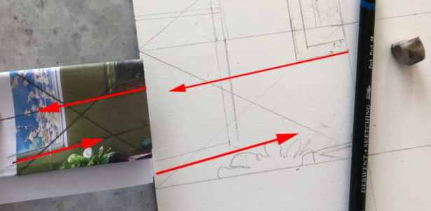a section from a reference photo folded into a rectangle, and a rectangular square drawn on paper as a guide