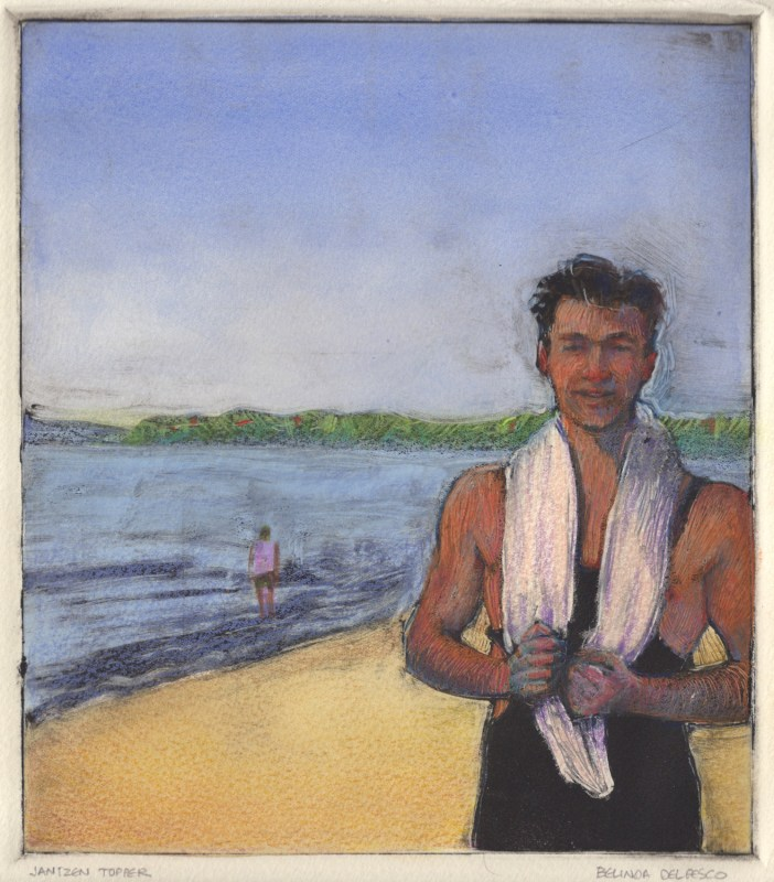 a man on the beach with a white towel slung over his neck and a figure in the water behind him