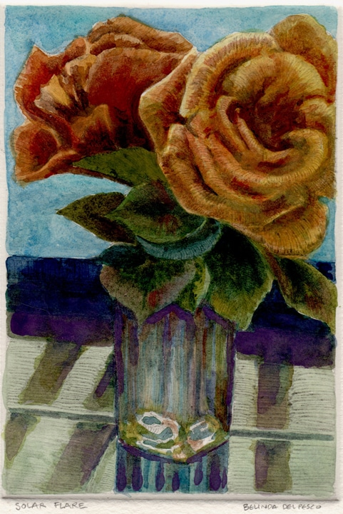 two orange roses in a green bud vase against a windowsill on a tile counter