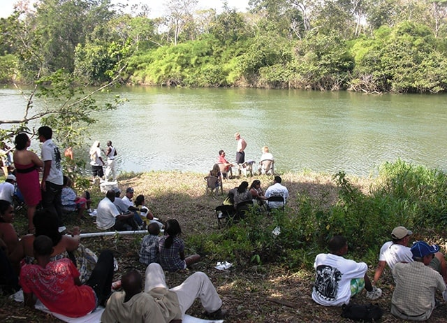 Locals relaxing by the river bank in Burrel Boom