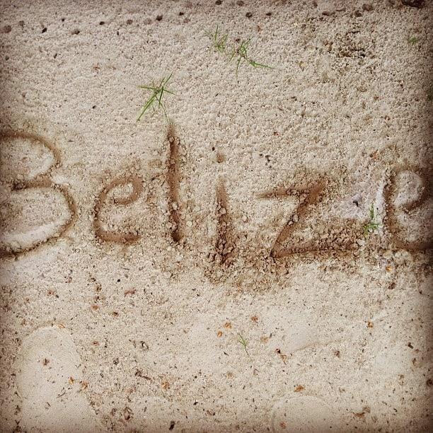 belize written on the beach