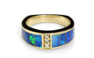 a gold ring with opal and diamonds